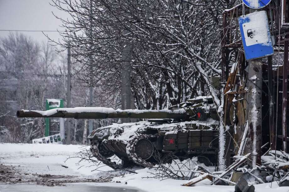 A pro-Russian rebels' tank stands behind a destroyed bus stop near Donetsk airport, Eastern Ukraine, Tuesday, Jan. 6, 2015. Ukrainian soldiers took up duties Tuesday at the Donetsk Airport, scene of some of the fiercest fighting in eastern Ukraine. The 50 soldiers in a convoy of four trucks were provided safe passage to the airport by rebel forces, who gave them gifts in celebration of Orthodox Christmas. (AP Photo/Mstyslav Chernov) Photo: AP / AP