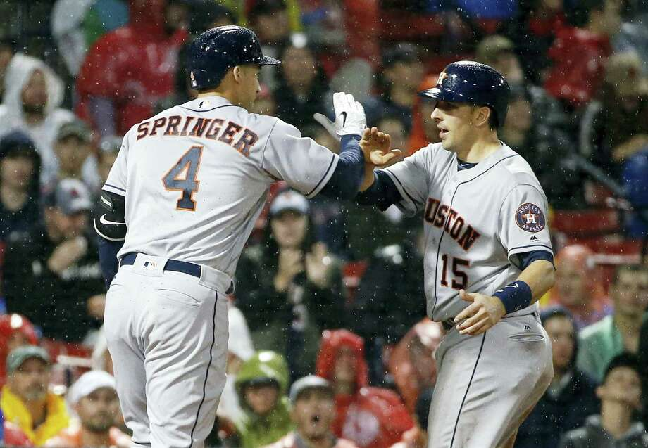 The Astros' George Springer, left, celebrates his two-run home run during the sixth inning on Friday. Photo: Michael Dwyer — The Associated Press  / Copyright 2016 The Associated Press. All rights reserved. This material may not be published, broadcast, rewritten or redistribu