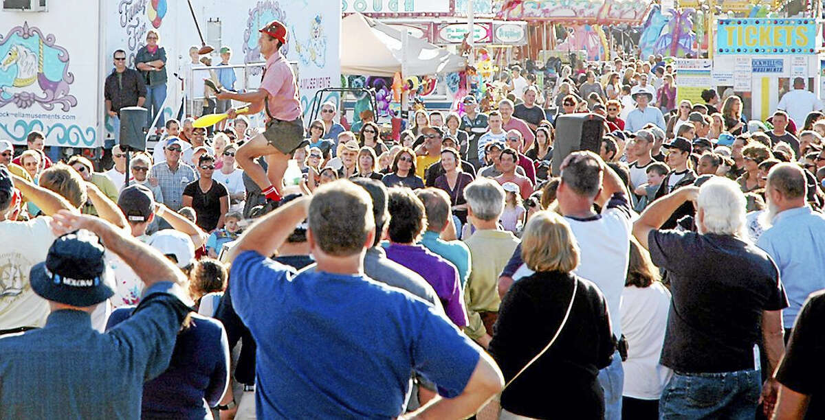 A juggler attracts a crowd at last year's Guilford Fair.