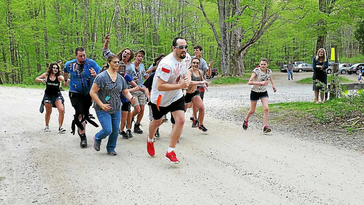 Runner Matt Collins, 29, of Washington attempts to evade the hordes of zombies prior to the 5K Zombie Run Against Epilepsy on Saturday afternoon at Steep Rock Preservation at 2 Tunnel Road in Washington Depot.