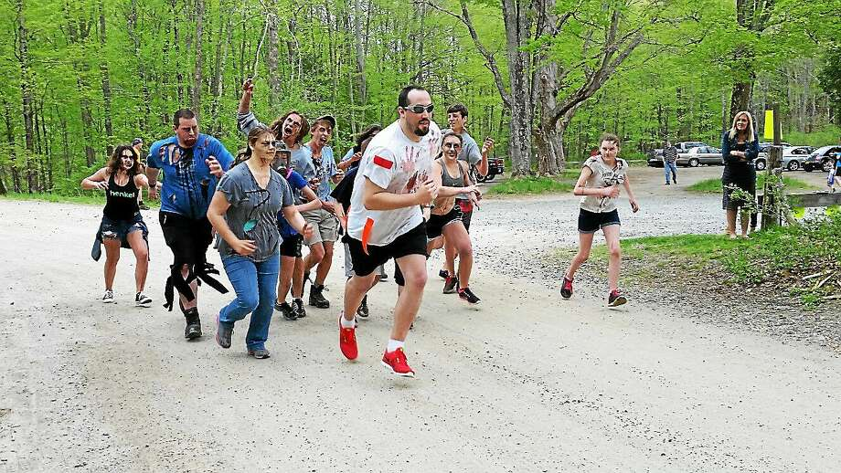 Runner Matt Collins, 29, of Washington attempts to evade the hordes of zombies prior to the 5K Zombie Run Against Epilepsy on Saturday afternoon at Steep Rock Preservation at 2 Tunnel Road in Washington Depot. Photo: Noel Ambery - Register Citizen