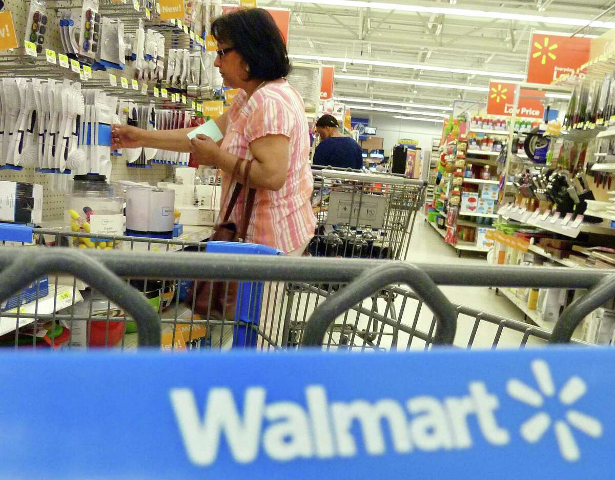 AP Photo/Elise Amendola Shoppers look at merchandise at Walmart in Danvers, Mass.