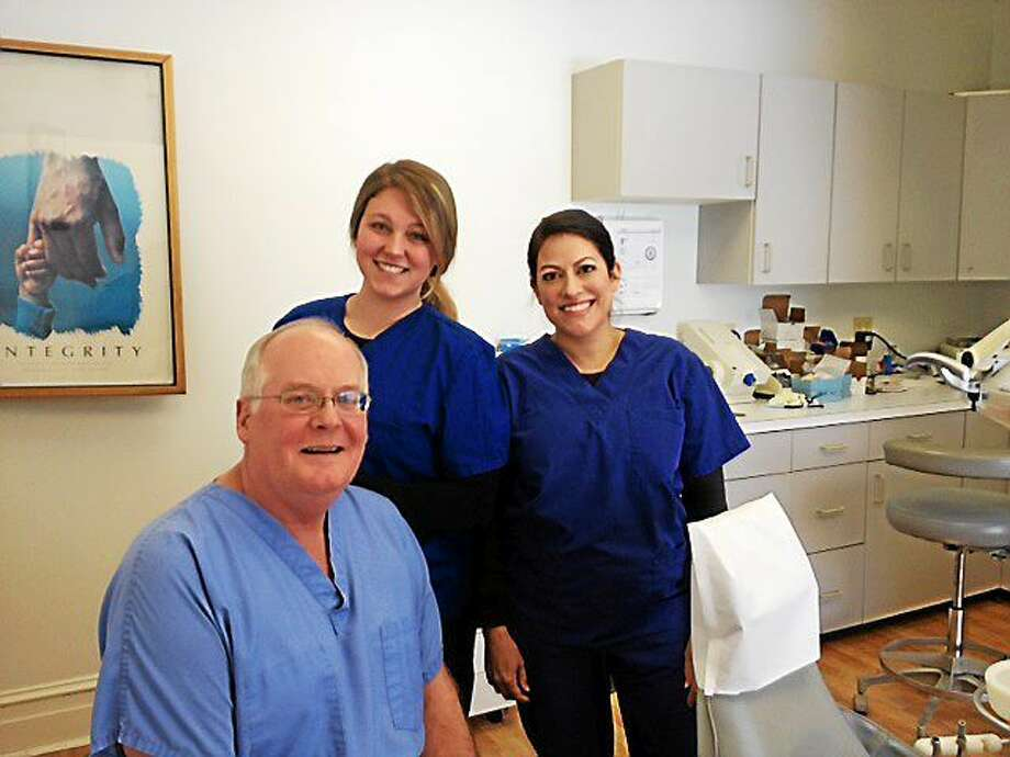 J.P. Simoncelli, DDS, Shelby Fiore and Jen Hauck in Simoncelli's office. Photo: Kaitlin McCallum — The Register Citizen