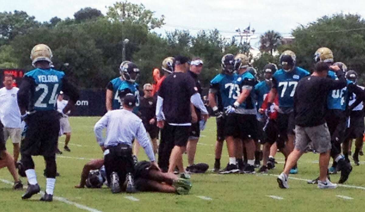 Jaguars first-round draft pick Dante Fowler is tended to after being injured at minicamp on Friday in Jacksonville, Fla.