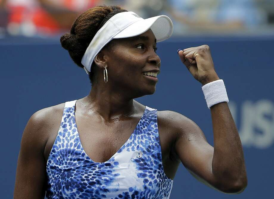 Venus Williams reacts to her coach's box after defeating Belinda Bencic during the third round of the U.S. Open on Friday in New York. Photo: Matt Rourke — The Associated Press  / AP