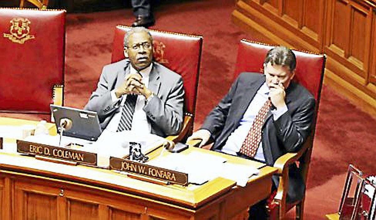 State Sens. Eric Coleman and John Fonfara sit in the Senate chamber.