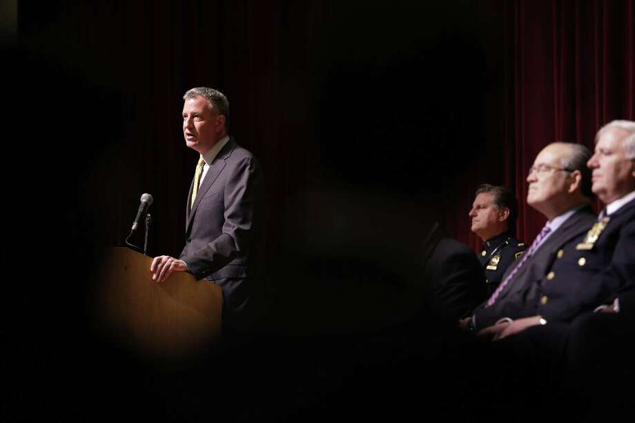 New York City Mayor Bill de Blasio speaks during an New York Police Department swearing-in ceremony in New York on Jan. 7. De Blasio was speaking to hundreds of new police hires who will be spending the next six months in police academy before becoming police officers. Photo: AP Photo  / AP