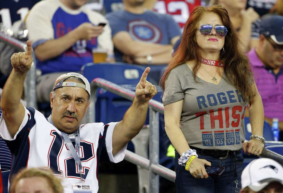 New England Patriots fans show their support for Tom Brady before Thursday's preseason game against the New York Giants in Foxborough, Mass.