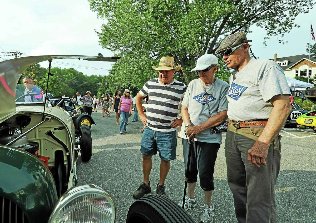 From left, Bob DeMichiel, of Northfield, Bobbie Milligan of Andover, Mass.; and Don Milligan of Andover check out the vintage vehicles.