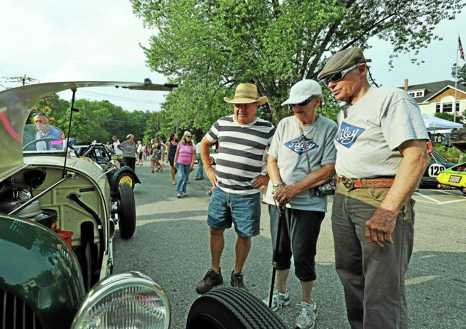 From left, Bob DeMichiel, of Northfield, Bobbie Milligan of Andover, Mass.; and Don Milligan of Andover check out the vintage vehicles. Photo: Journal Register Co.