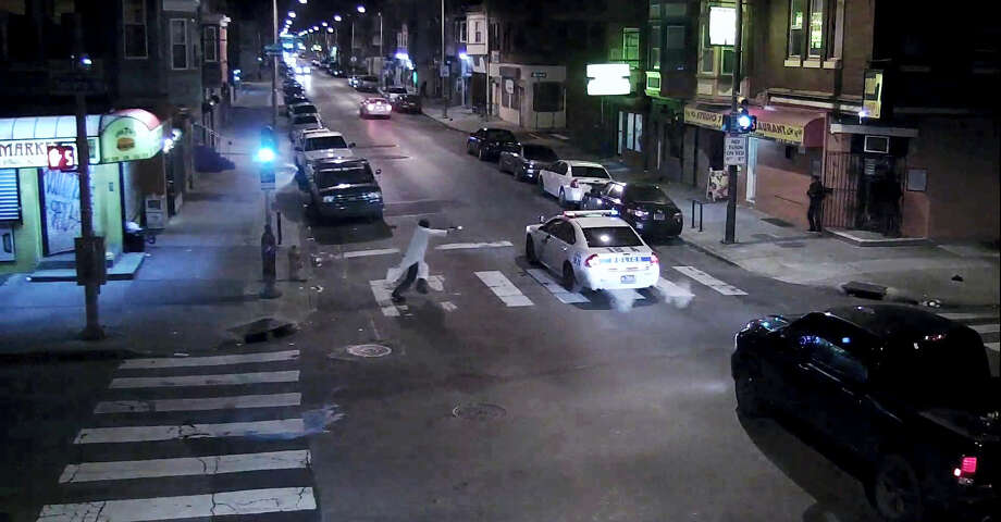 In this frame from a Thursday, Jan. 7, 2016 video provided by the Philadelphia Police Department, Edward Archer runs with a gun toward a police car driven by Officer Jesse Hartnett in Philadelphia. Archer, using a gun stolen from police, said he was acting in the name of Islam when he ambushed Hartnett sitting in his marked cruiser at an intersection, firing shots at point-blank range, authorities said. Photo: Philadelphia Police Department Via AP / Philadelphia Police Department