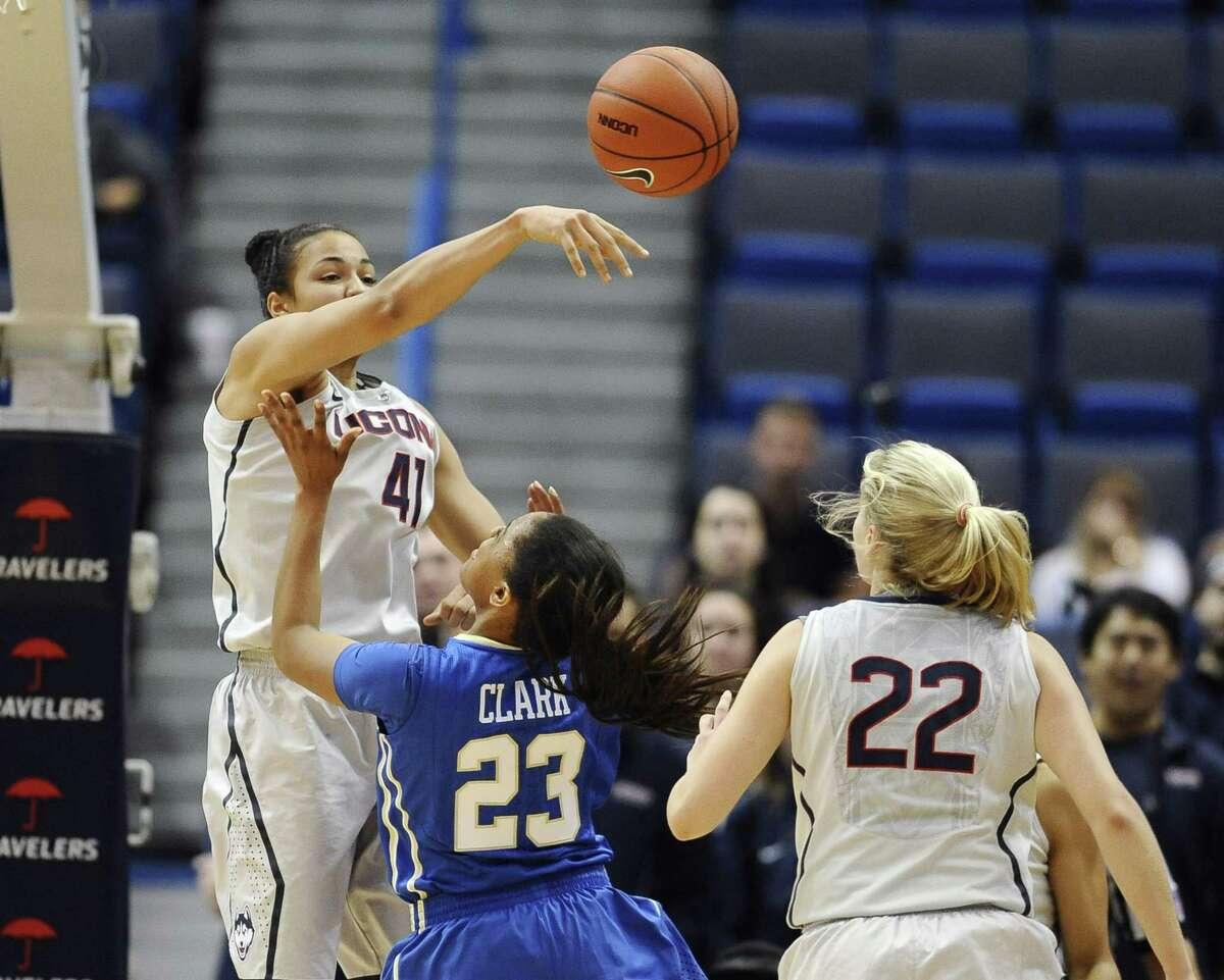 UConn's Kiah Stokes, left, blocks a shot attempt by Tulsa's Ashley Clark in Wednesday's game. UConn won 98-60.