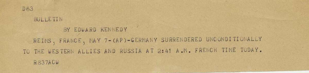 This undated photograph shows the news bulletin sent by Associated Press Paris Bureau Chief Edward Kennedy announcing the unconditional surrender of the Germans to the Allies on May 7, 1945.