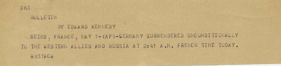 This undated photograph shows the news bulletin sent by Associated Press Paris Bureau Chief Edward Kennedy announcing the unconditional surrender of the Germans to the Allies on May 7, 1945. Photo: THE ASSOCIATED PRESS  / AP Corporate Archives
