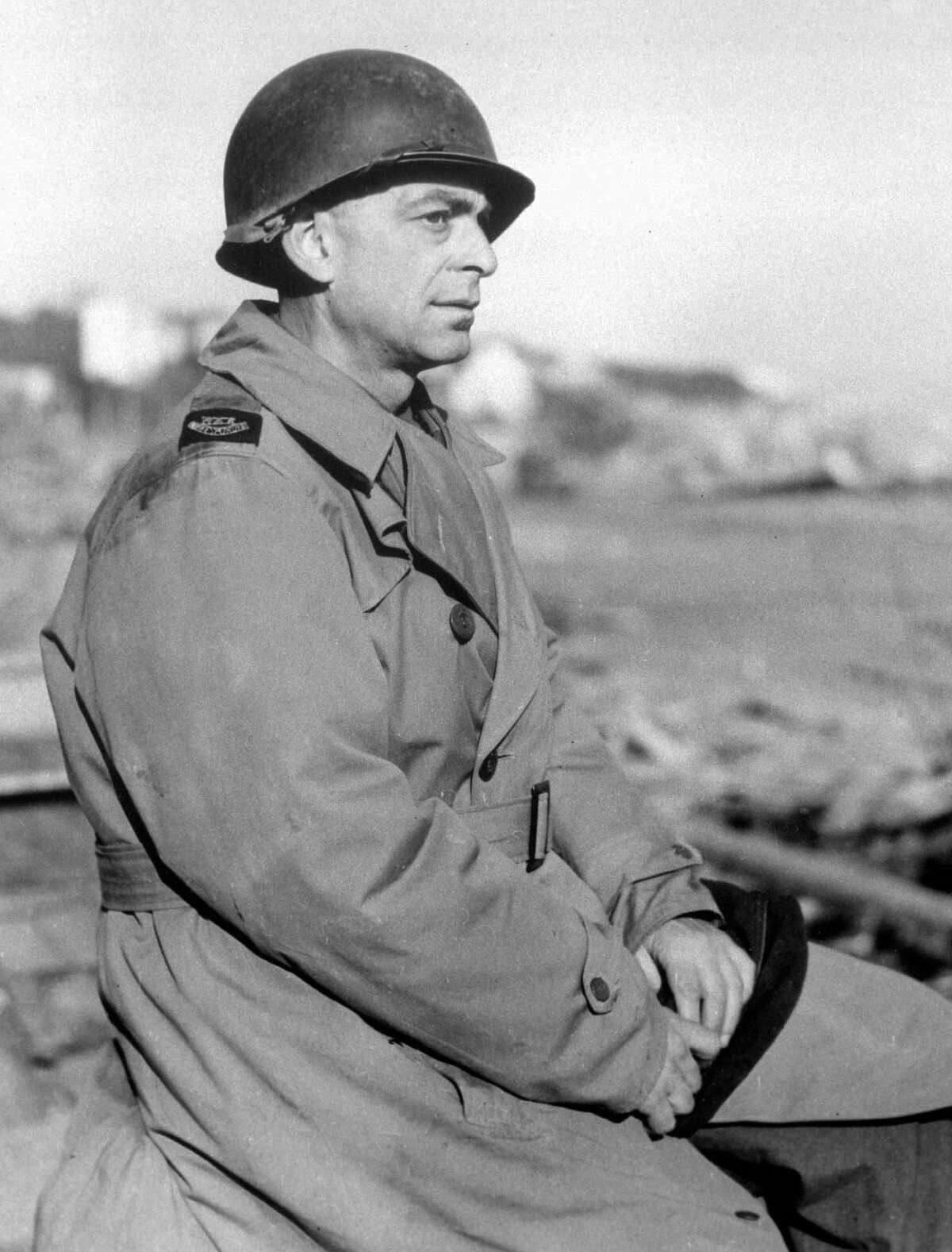 In this March 1, 1944, photo, Ed Kennedy, chief of The Associated Press staff in North Africa, wears a metal helmet at the Anzio beachhead in Italy.