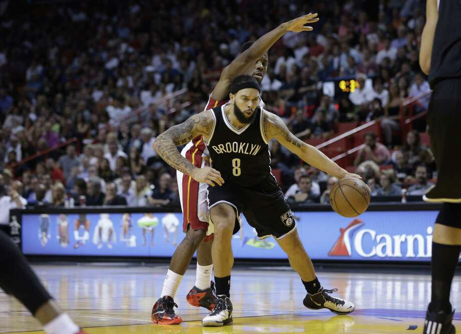 Brooklyn Nets guard Deron Williams will miss at least a week with a fractured rib. Photo: Lynne Sladky — The Associated Press  / AP