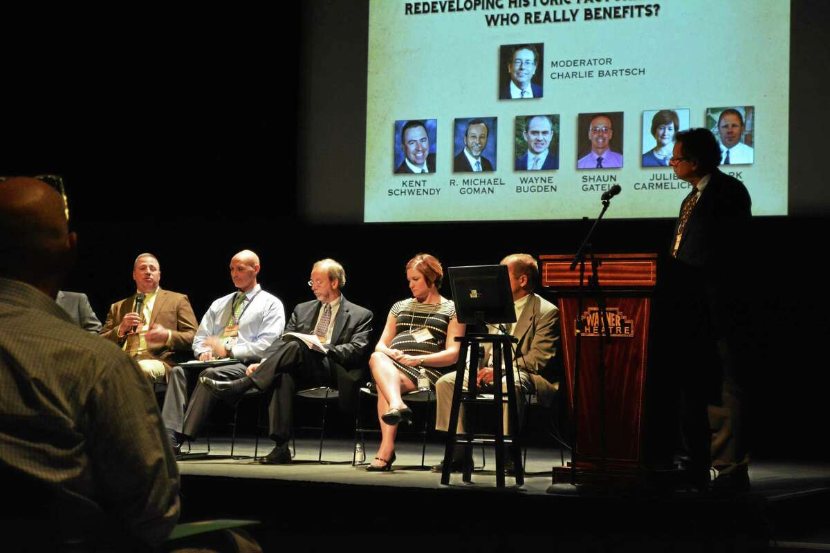 A panel discussion on the benefits of redeveloping historic factories was held as part of an all-day symposium at the Warner Theatre.