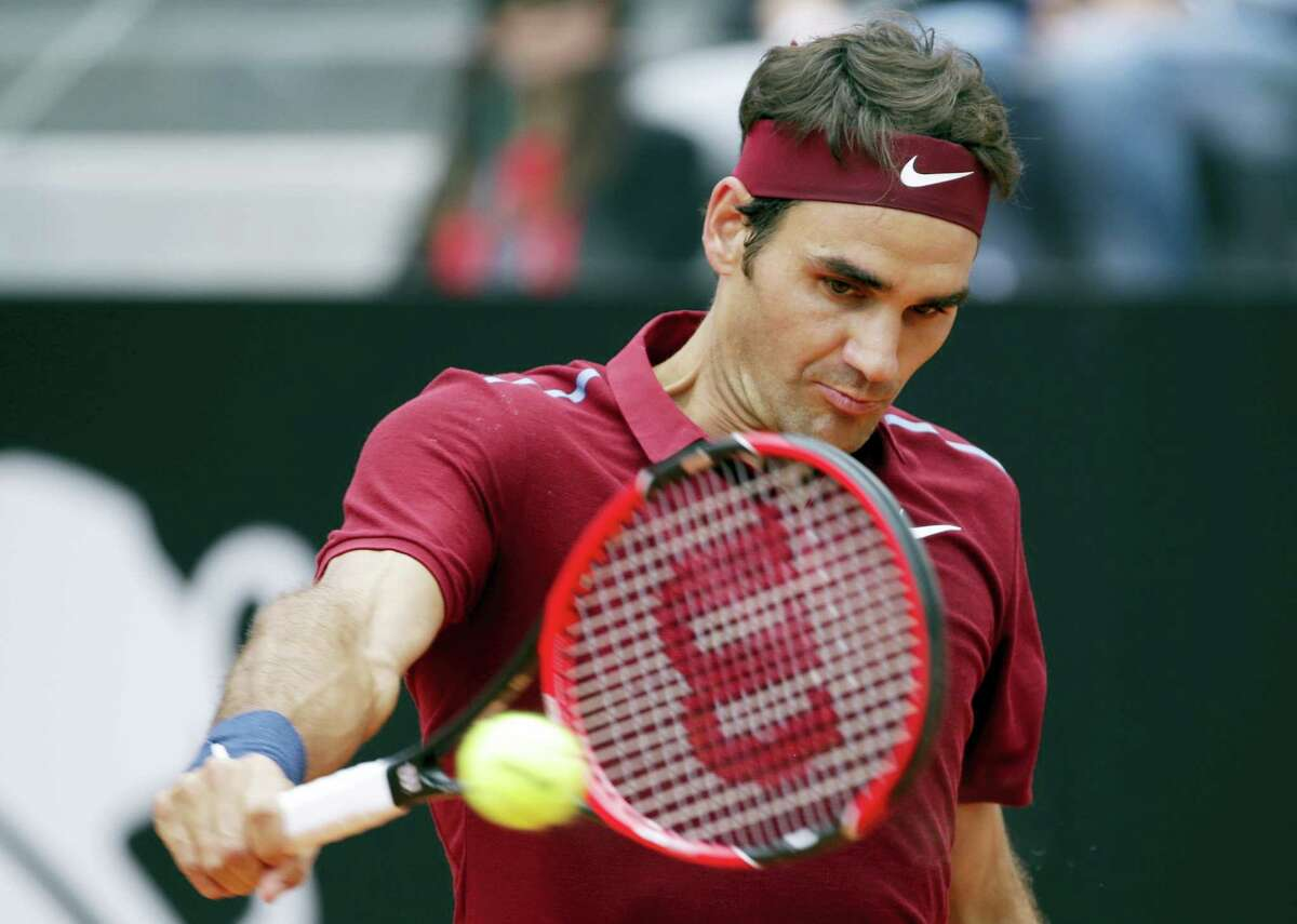 Roger Federer of Switzerland returns the ball to Dominic Thiem of Austria during their match at the Italian Open tennis tournament, in Rome, Thursday, May 12, 2016. (AP Photo/Andrew Medichini)