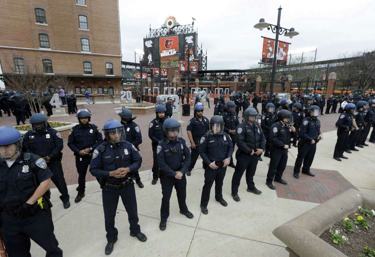 Police stand in formation outside Oriole Park at Camden Yards during a protest for Freddie Gray on April 25 in Baltimore.