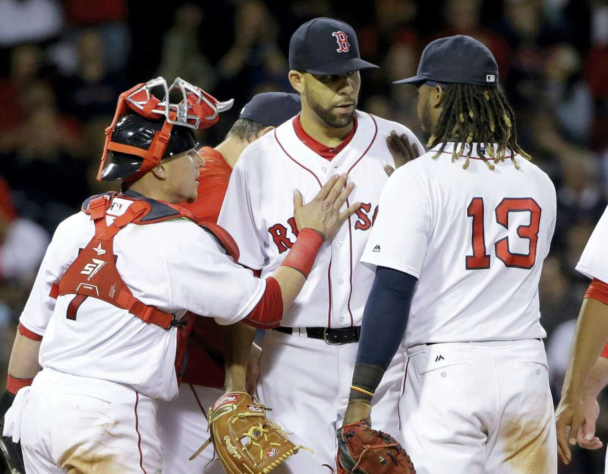 Boston Red Sox starting pitcher David Price receives pats from catcher Christian Vazquez (7) and first baseman Hanley Ramirez (13) as he is taken out during the seventh inning of a baseball game against the Houston Astros at Fenway Park, Thursday, May 12, 2016, in Boston. (AP Photo/Elise Amendola)