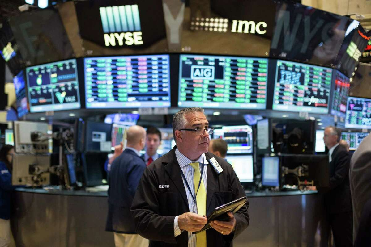 Traders work at the New York Stock Exchange Friday in New York.