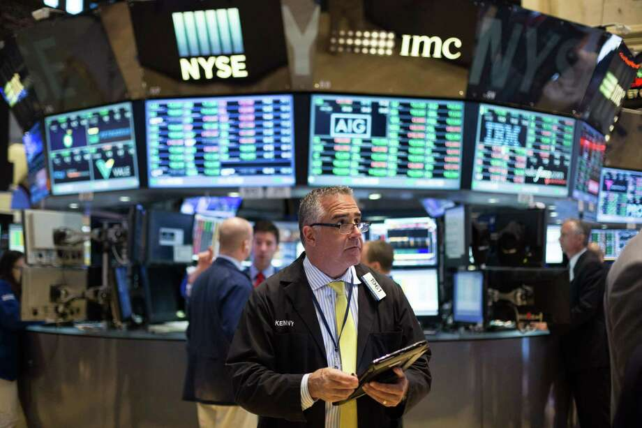 Traders work at the New York Stock Exchange Friday in New York. Photo: Kevin Hagen — The Associated Press  / FRE 170574