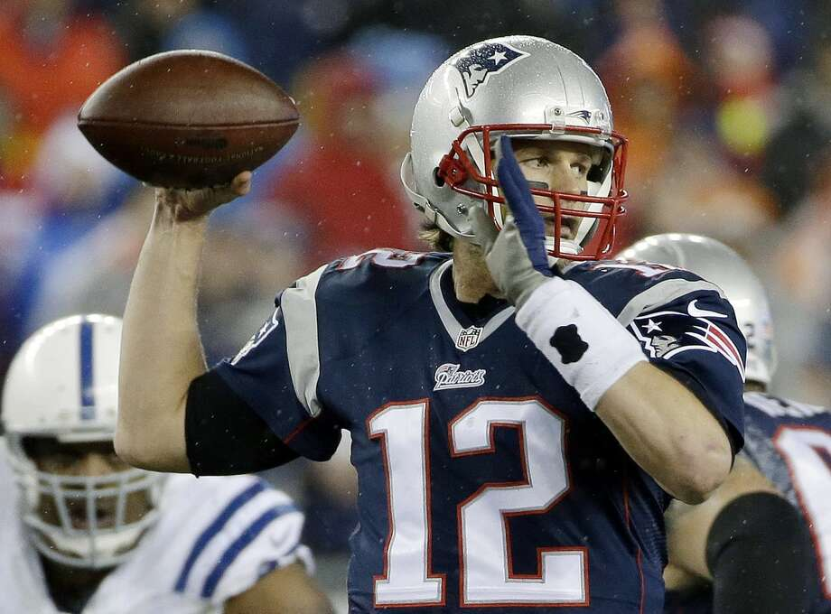 In this Jan. 18, 2015 photo, New England Patriots quarterback Tom Brady looks to pass during the first half of the NFL football AFC Championship game against the Indianapolis Colts in Foxborough, Mass. Photo: AP Photo/Matt Slocum, File  / AP
