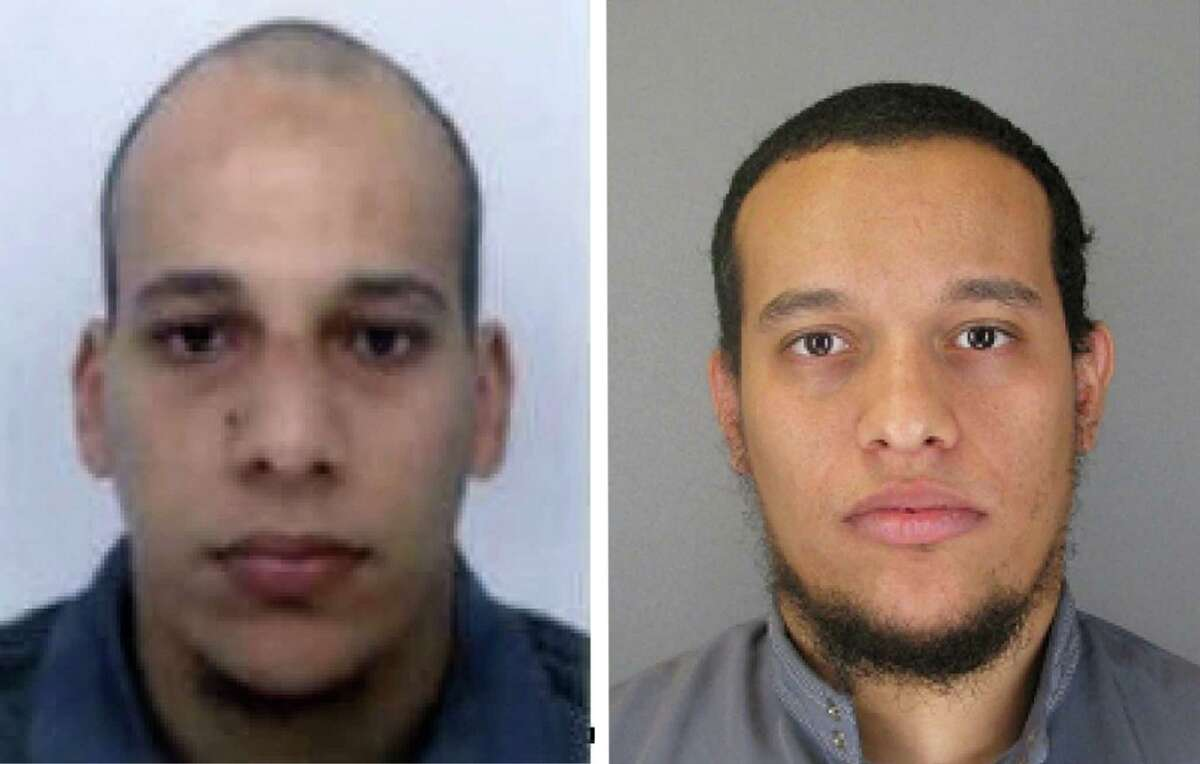 """This photo provided by The Paris Police Prefecture Thursday, Jan.8, 2015 shows the suspects Cherif, left, and Said Kouachi in the newspaper attack along with a plea for witnesses. Police hunted Thursday for two heavily armed men, one with possible links to al-Qaida, in the methodical killing of 12 people at a satirical newspaper that caricatured the Prophet Muhammed. France began a day of national mourning for what its president called """"an act of exceptional barbarism. (AP Photo/Prefecture de Police de Paris)"""