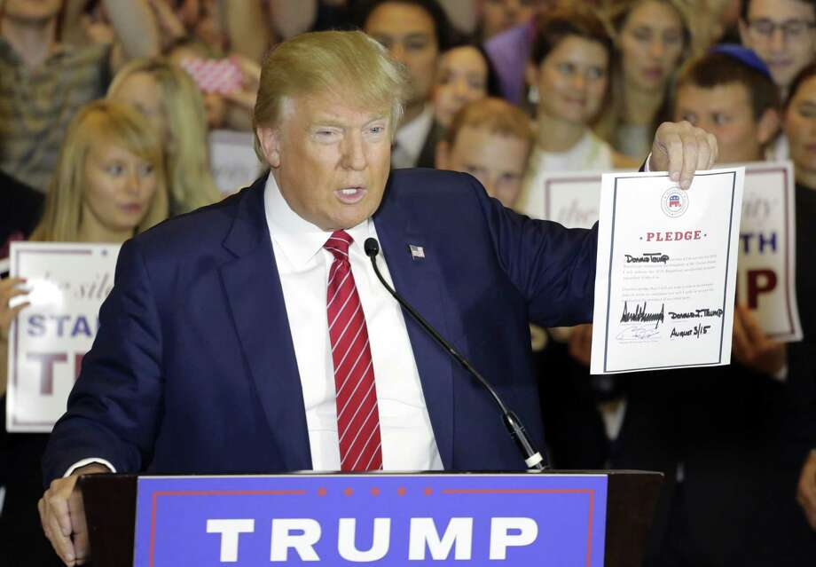 Republican presidential candidate Donald Trump holds a signed pledge during a news conference in Trump Tower Thursday in New York. Trump ruled out the prospect of a third-party White House bid and vowed to support the Republican Party's nominee, whoever it may be. Photo: AP Photo  / AP