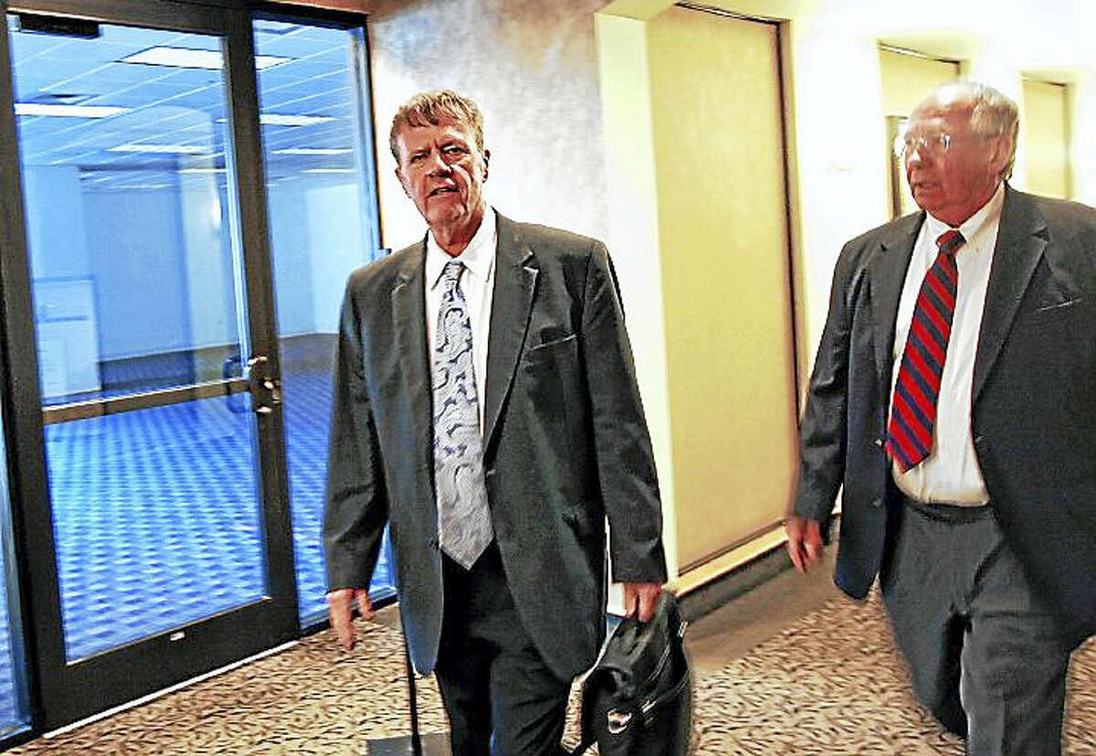 Screenshot via concordmonitor.com: This Nov. 24, 2014 photo shows Fred Fuller, left, arriving at bankruptcy court in Manchester. (Don Himsel — Nashua Telegraph)