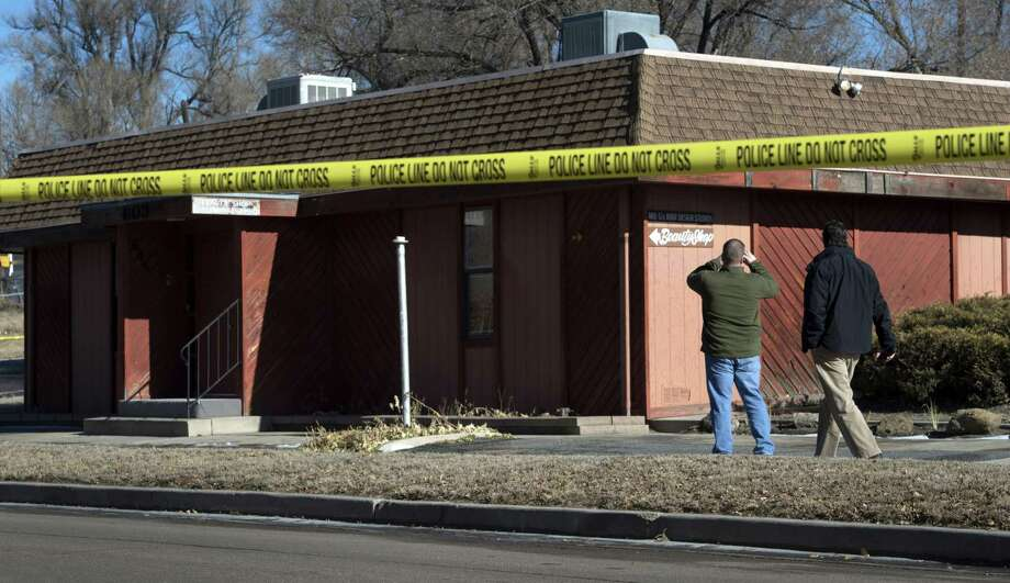 Colorado Springs police officers investigate the scene of an explosion Tuesday, Jan. 6, 2015, at Mr. G's Hair Salon at 603 S. El Paso Street in Colorado Springs, Colo. Photo: Christian Murdock — The Colorado Springs Gazette — The Associated Press  / The Colorado Springs Gazette