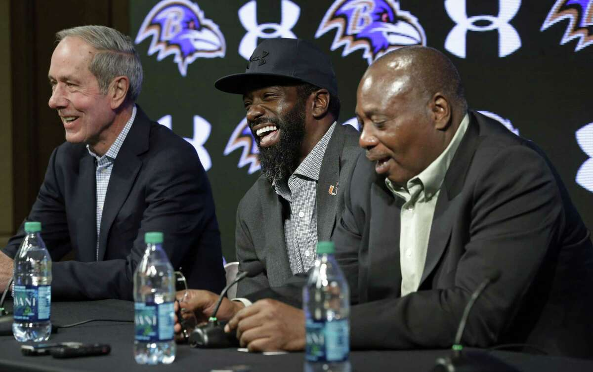 Baltimore Ravens safety Ed Reed, center, laughs at a Thursday news conference while announcing his retirement alongside team president Dick Cass, left, and general manager and executive vice president Ozzie Newsome in Owings Mills, Md.