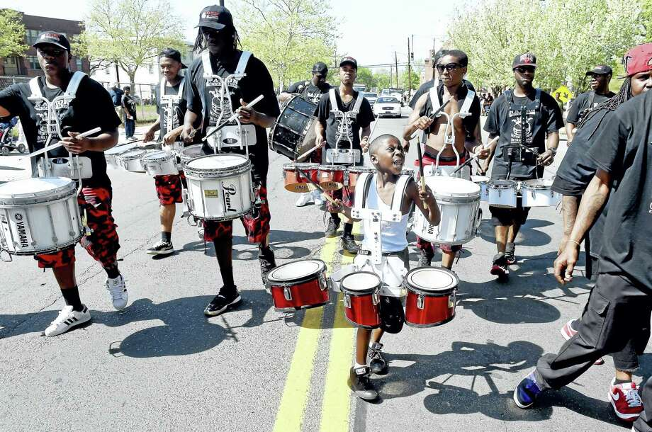 Young Julian Threadgill, center, drums with the New Haven-based Nation Drill Squad and Drum Corp during last year's parade. Photo: Arnold Gold — Register