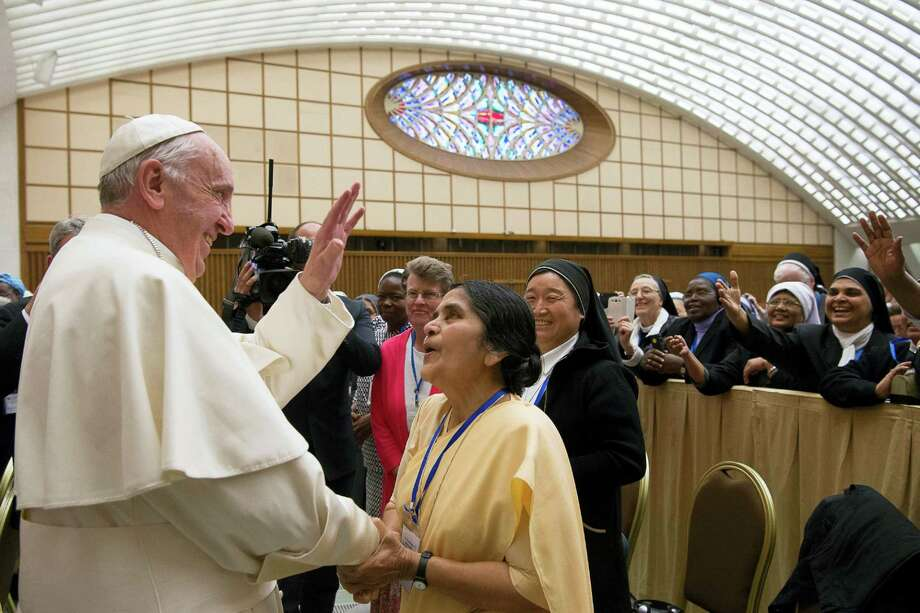 Pope Francis greets participants in a special audience with members of the International Union of Superiors General in the Paul VI hall at the Vatican, Thursday, May 12, 2016. Pope Francis said Thursday he is willing to create a commission to study whether women can be deacons in the Catholic Church, signaling an openness to letting women serve in ordained ministry currently reserved to men. Photo: L'Osservatore Romano/Pool Photo Via AP   / L'Osservatore Romano