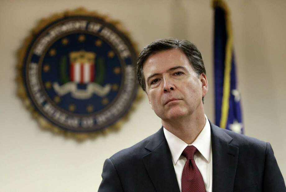 In this Feb. 27, 2014 file photo, Federal Bureau of Investigation Director James B. Comey listens to a question from a reporter during a media conference in San Francisco. (AP Photo/Ben Margot, File) Photo: AP / AP