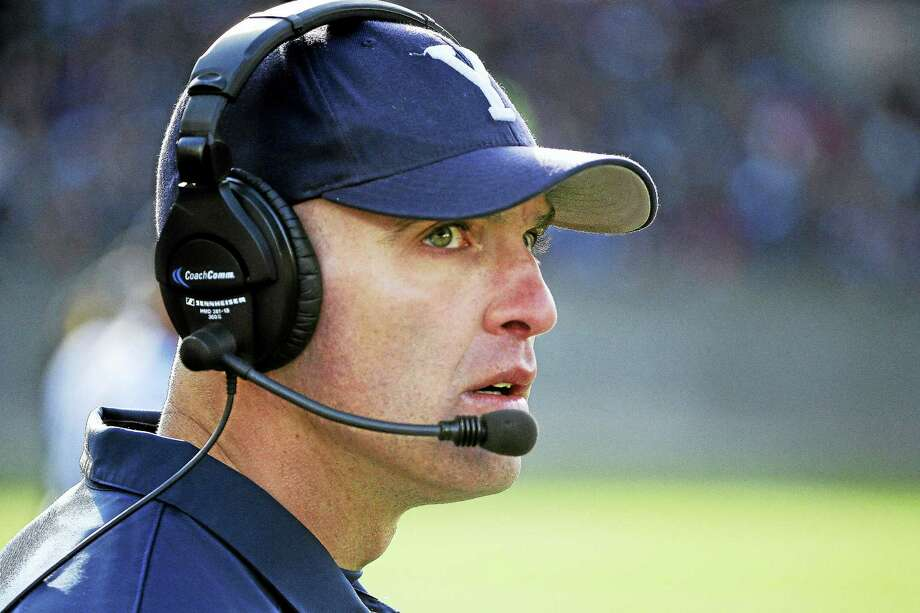 Yale head coach Tony Reno watches his team during the first half of an NCAA college football game against Harvard at Harvard Stadium Saturday, Nov. 22, 2014 in Cambridge, Mass. Harvard defeated Yale 31-24 to remain undefeated and win the Ivy League Championship. (AP Photo/Stephan Savoia) Photo: AP / AP