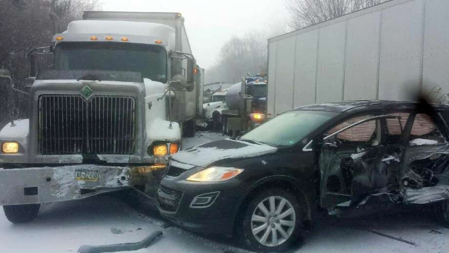 In this photo provided by exploreClarion.com/Bauer Truck Repair, vehicles remain at the scene of a fatal 18-vehicle pileup that occurred in whiteout conditions Wednesday, Jan. 7, 2015, on Interstate 80 near Clarion, Pa. State police said that two people who died were struck after exiting their vehicles at the scene. The victims' identities were not being released until families could be notified. (AP Photo/exploreClarion.com/Bauer Truck Repair) Photo: AP / exploreClarion.com/Bauer Truck Repair