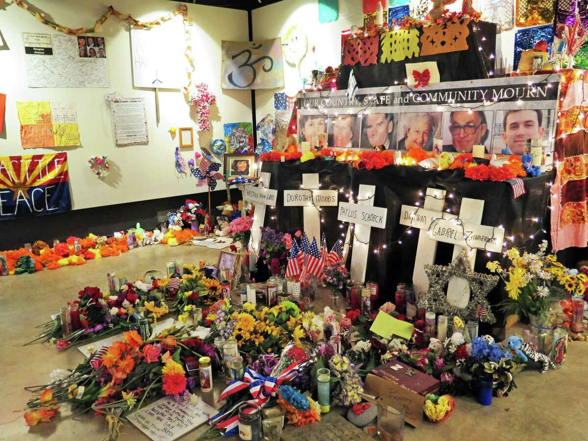Flowers, teddy bears and inspirational posters line a room at the Arizona History Museum in Tucson in this Wednesday, Jan. 7, 2015 photo. The items were left at the scene of the Jan. 8, 2011 shooting in Tucson that left six dead and 13 wounded. Former Rep. Gabby Giffords was the target and suffered a gunshot wound to the head from which she is still recovering. So many items were left at the shooting site and at University Medical Center, where victims were treated, that a non-profit group stored them in a warehouse for several years. They have been at display at an exhibit at the museum since October, 2014, but will be removed Friday, Jan. 8. (AP Photo/Astrid Galv·n)
