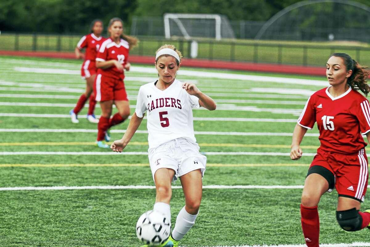 Torrington sophomore Kristina Michaud (5) scored three goals in the second half's first 6 minutes Wednesday night against Derby at Torrington High School.