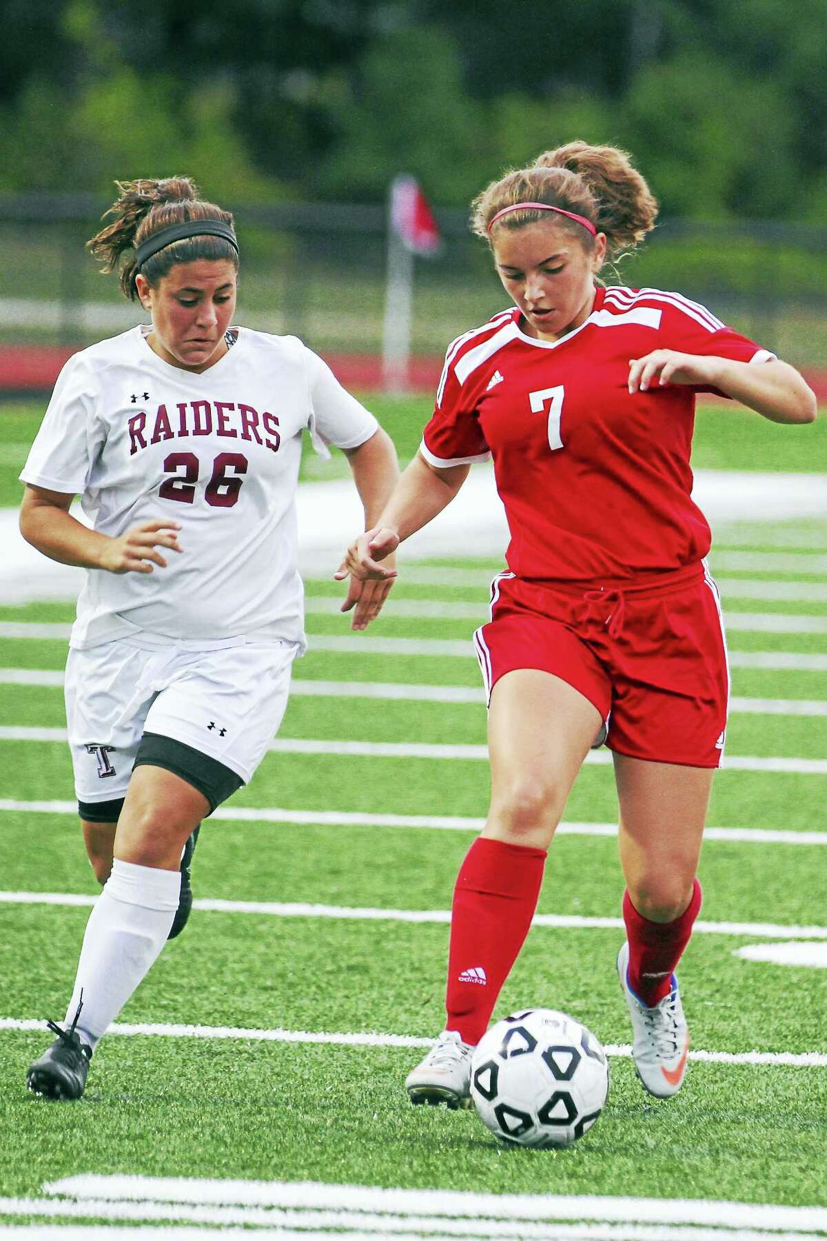 Torrington senior Alexis Tyrrell (26) takes on freshman Kaitlyn Gerkins in Torrington's rout of Derby Wednesday night at the Robert H. Frost Sports Complex.