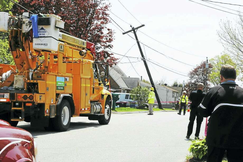 Greenridge Road in Torrington was shut down briefly on Thursday after a recycling truck hit a utility pole and live wires landed on his truck. There were no injuries reported. Photo: Viktoria Sundqvist — The Register Citizen