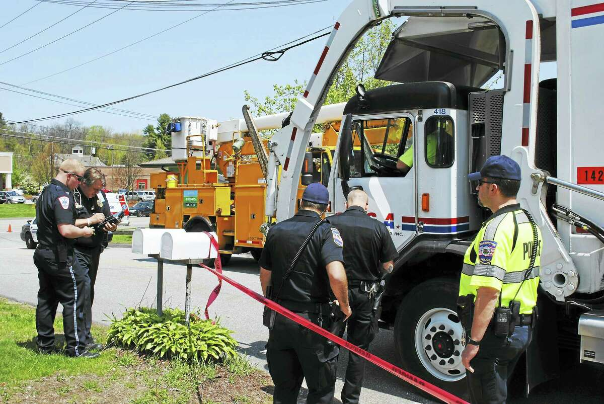 Greenridge Road in Torrington was shut down briefly on Thursday after a recycling truck hit a utility pole and live wires landed on his truck. There were no injuries reported.