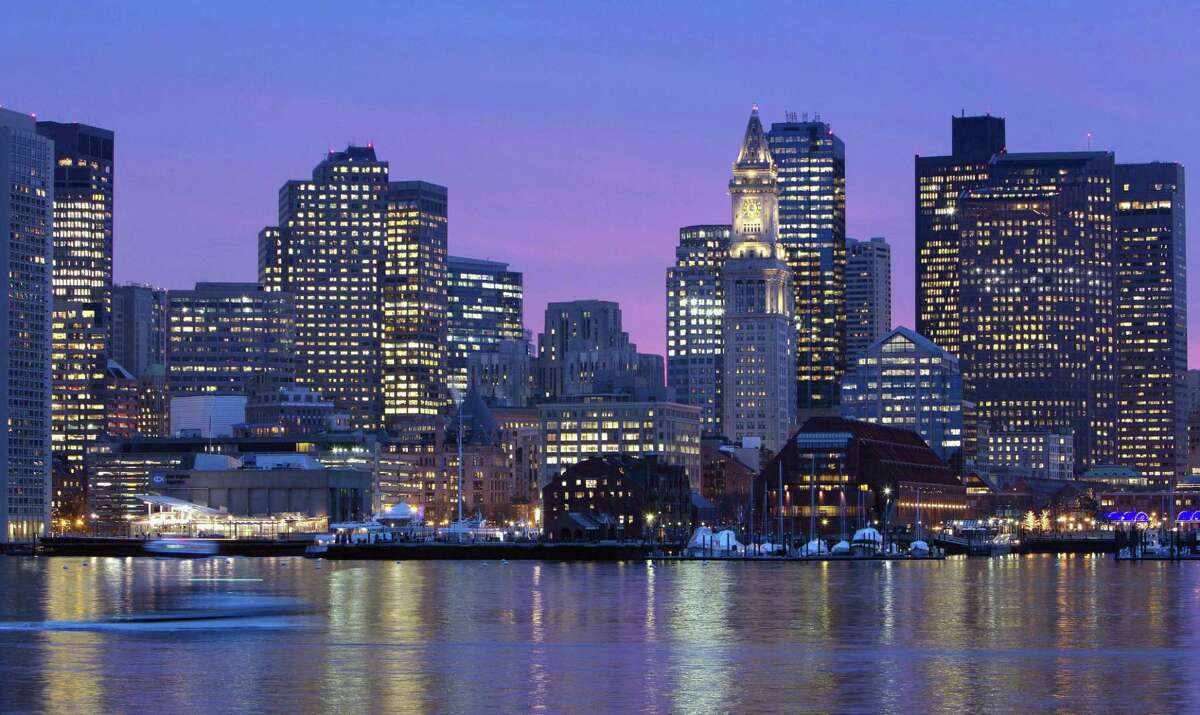 FILE - In this Jan. 6, 2012 file photo, the Boston city skyline is illuminated at dusk as it reflects off the waters of Boston Harbor. When the leaders of the U.S. Olympic Committee meet Thursday, Jan. 8, 2015, they'll be deciding on more than a city to put in the running to host the 2024 Summer Games.