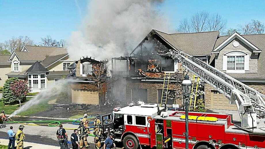 Crews battle a blaze at a condominium complex off Clark Road in Litchfield on Thursday. Photo: Ben Lambert — The Register Citizen
