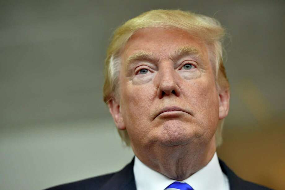In this Aug.  27, 2015 photo, Republican presidential candidate Donald Trump listens during a news conference after speaking at the TD Convention Center, in Greenville, S.C. Photo: AP Photo/Richard Shiro  / FR159523 AP