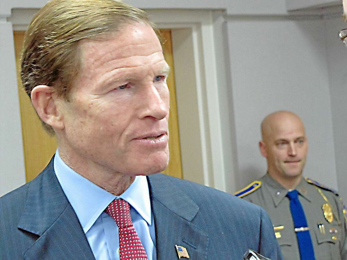Sen. Richard Blumenthal speaks to reporters during a visit to the state police crime lab in Meriden in this file photo.