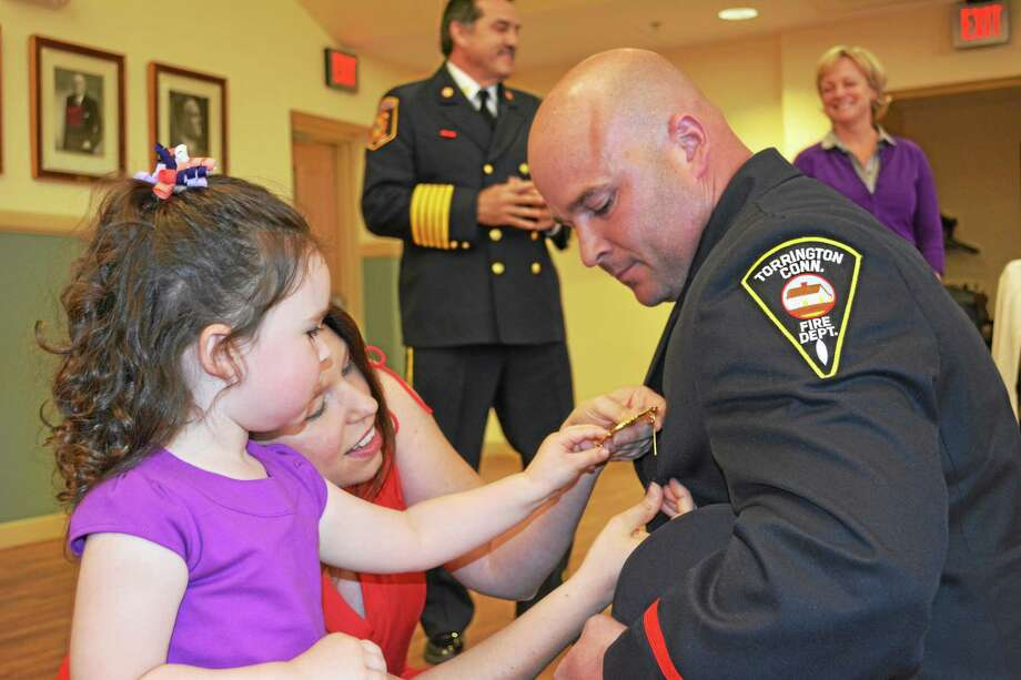 Members of the Torrington Police and Fire Departments were pinned for their new promotions during the Board of Public Safety meeting on Wednesday. Photo: Amanda Webster — The Register Citizen