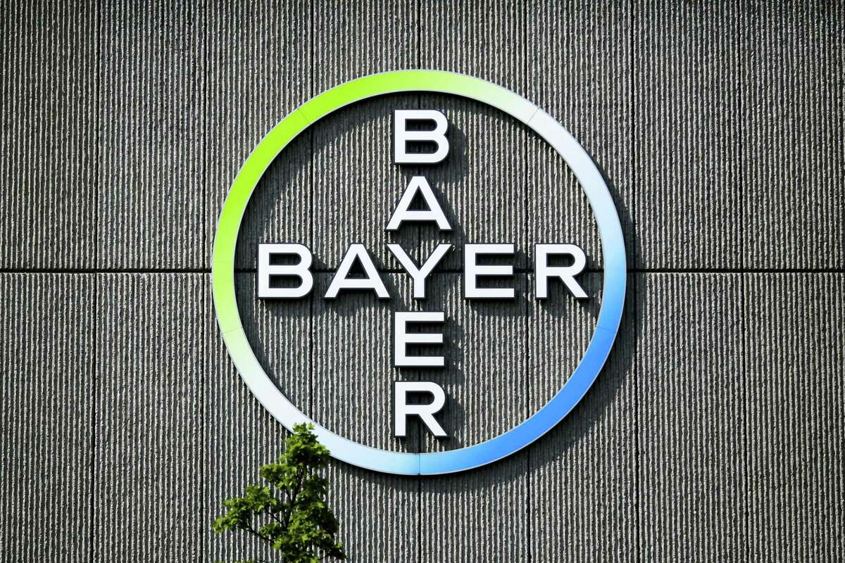In this May 23, 2016 picture the Bayer AG corporate logo is displayed on a building of the German drug and chemicals company in Berlin, Germany. German drug and farm chemical company Bayer AG said it signed a deal Wednesday, Sept. 14, 2016 to acquire seed and weed-killer company Monsanto for about $66 billion in cash.
