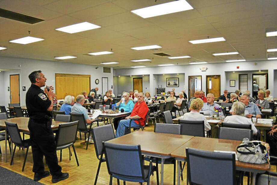 Officer Tony Pietrafesa spoke to members of the Sullivan Senior Center on Wednesday about senior safety tips. Photo: Amanda Webster — The Register Citizen