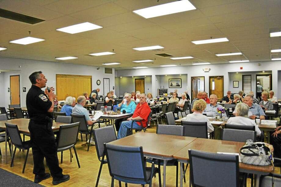 Officer Tony Pietrafesa spoke to members of the Sullivan Senior Center on Wednesday about senior safety tips. Photo: Amanda Webster — The Register Citizen